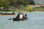 松尾祭  : 榊御面が神輿の先に神官とともに渡る。